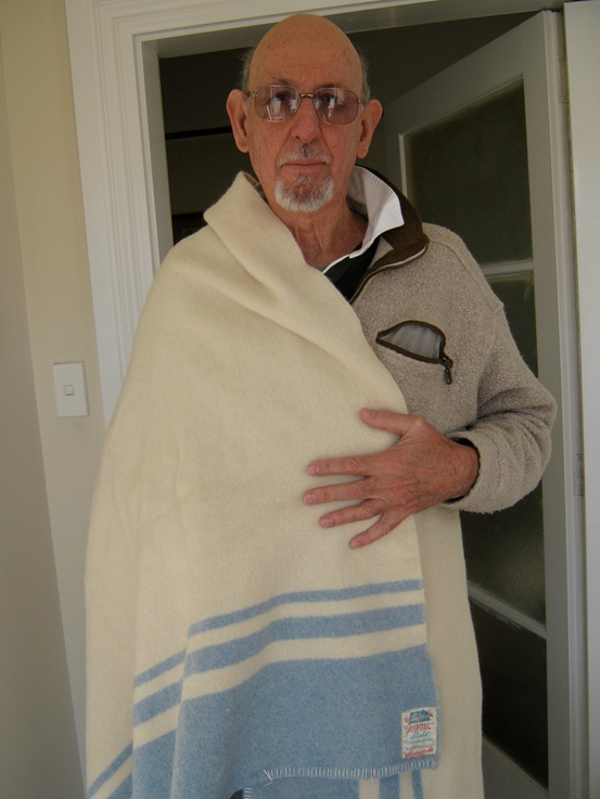 Warwick Johnston models a woolen mills blanket