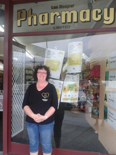 Lynda Battah outside the Len Hooper Pharmacy